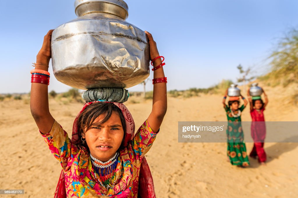 Indian Little Girls Carrying On Their Heads Water From Well Stock ...