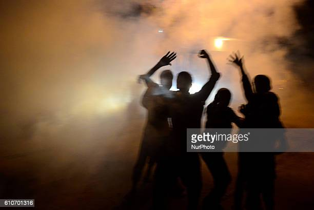 Indian local children play in smoke from fumigation in a busy old street of Allahabad on September 27201621 people died of dengue in last 3 weeks...