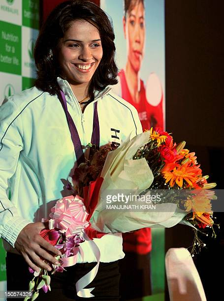 Indian London Olympic 2012 medalist for badminton Saina Nehwal attends a felicitation function organised by a global nutrition company in Bangalore...