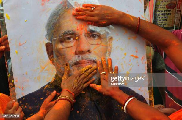 Indian Majority Political Party of BJP Supporters Celebrates Holi with Indian Prime Minister Narendra Modi Photograph after the announce Uttar...