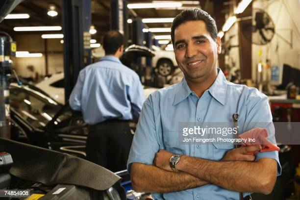 Indian male auto mechanic in shop