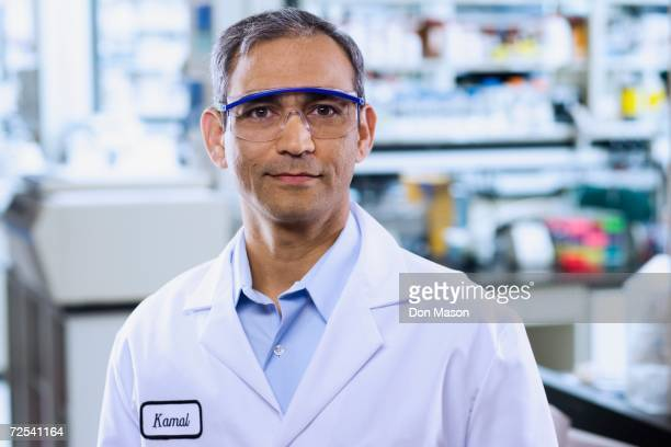 indian male scientist with protective eyewear - protective eyewear stock pictures, royalty-free photos & images