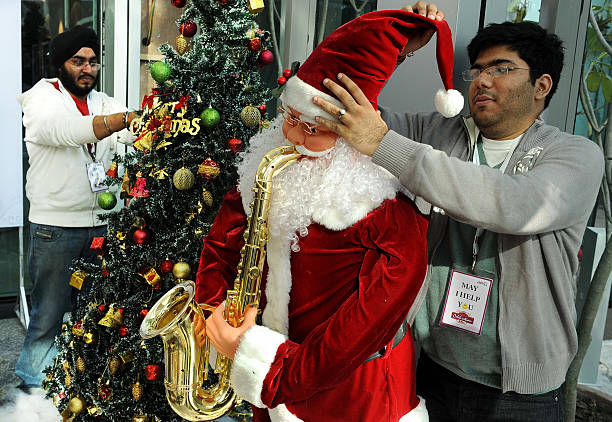 indian mall employees decorating a santa