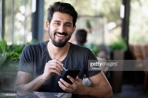 indian man at cafe - turkey middle east stock pictures, royalty-free photos & images