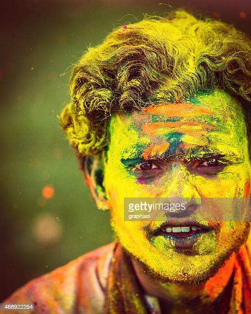 Indian man covered in holi festival colours