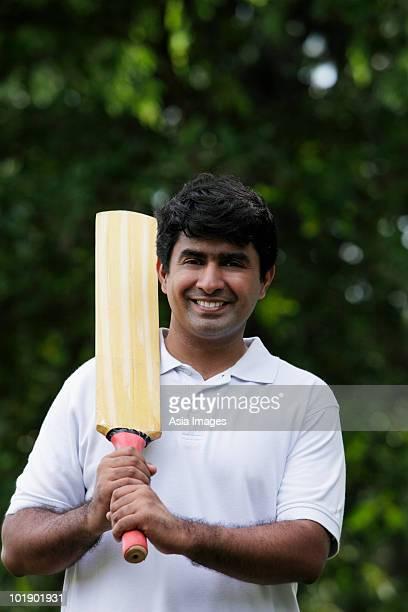 indian man holding cricket bat - cricket bat stock pictures, royalty-free photos & images