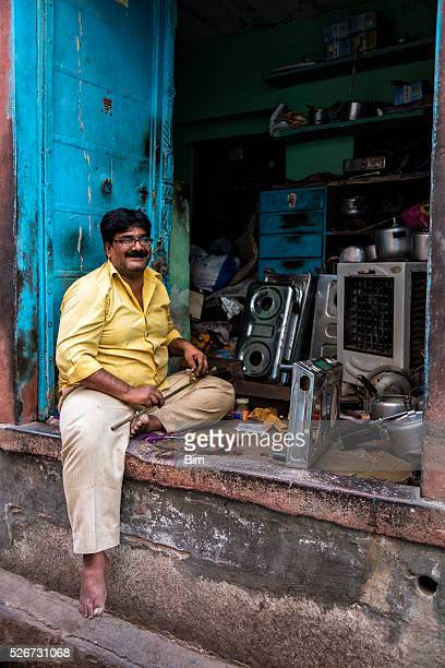 Indian man in front of his store, Bikaner, Rajasthan, India