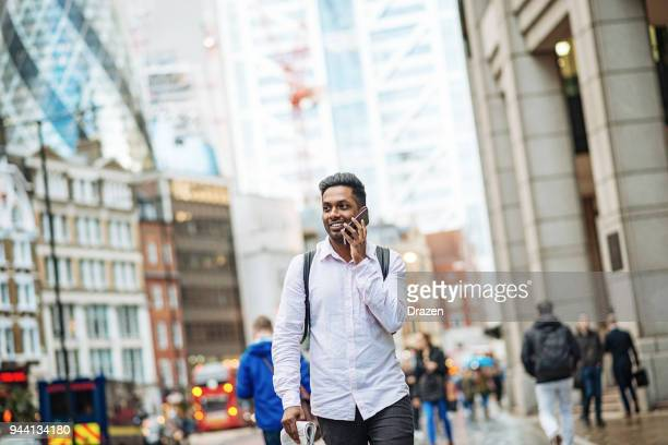 indian man living in big city - migrant worker stock pictures, royalty-free photos & images