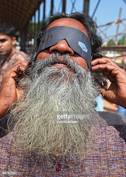 Indian man observes the rare Annular Solar Eclipse on January 15 2010 at the central stadium of Thiruvananthapuram in Kerala South IndiaThis rare...