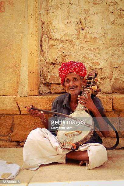 indian man playing traditional folk indian instrument - sarri stock pictures, royalty-free photos & images