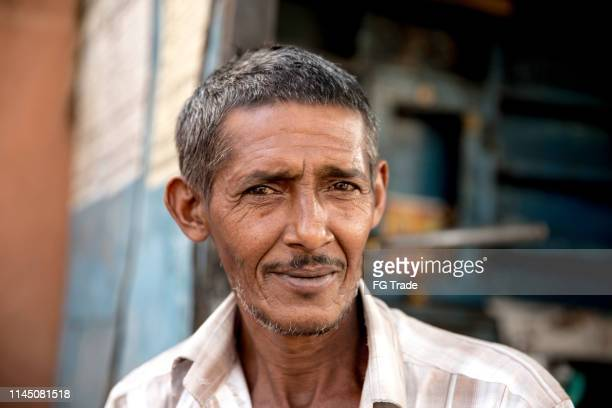indian man portrait outdoors - arab old man stock pictures, royalty-free photos & images
