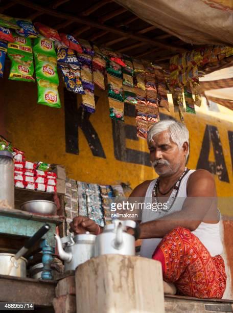 indian man preparing masala chai - garam masala stock photos and pictures