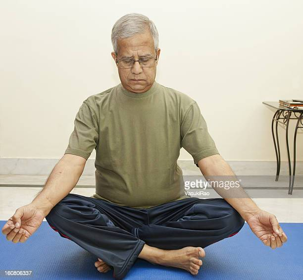 Indian man relaxes with yoga
