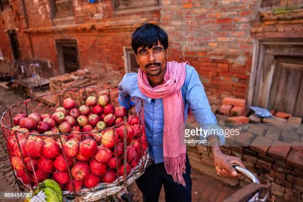Indian man selling fresh apples on the street, Bhaktapur