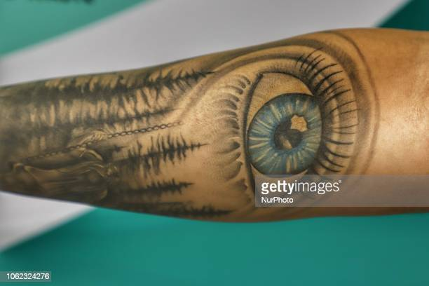 Indian Man Showing Illuminati Tattoo On His Arm In New Delhi India on 15 November 2018