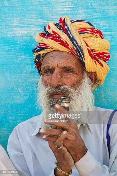 Indian man smoking a pipe