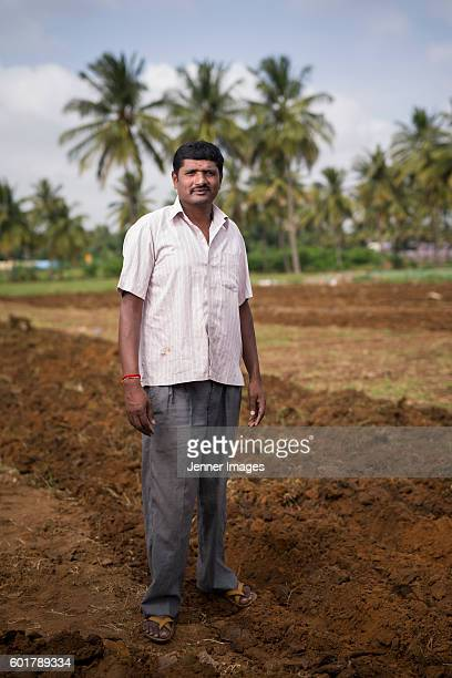 Indian man standing in his farm.