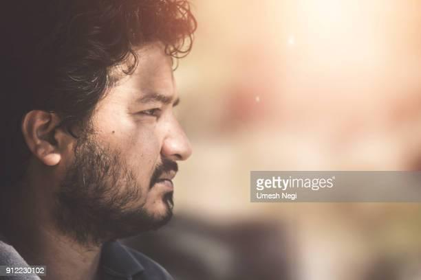 Indian Man thinking moody portrait