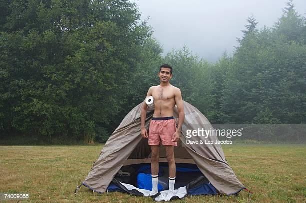 Indian man wearing boxer shorts at campsite