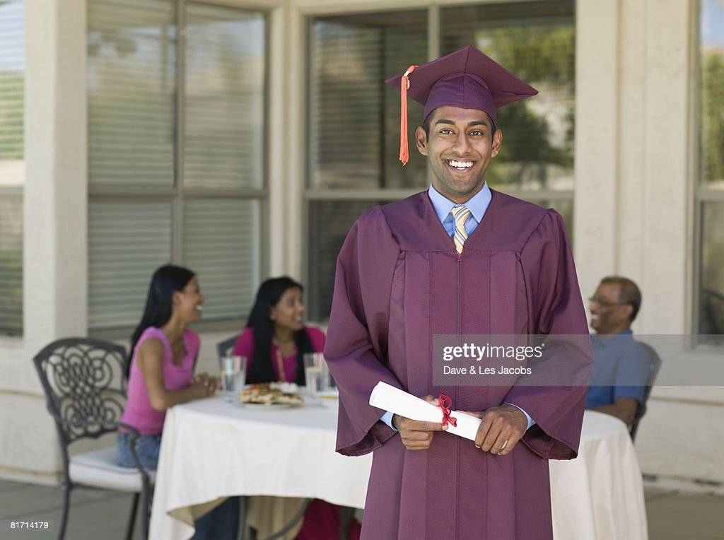 Indian Man Wearing Graduation Cap And Gown Stock Photo | Getty Images