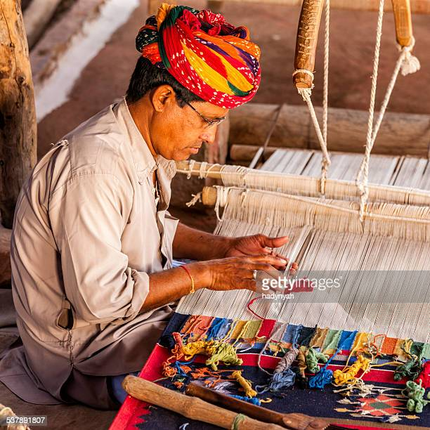 Indian man weaving textiles (durry) in Rajasthan