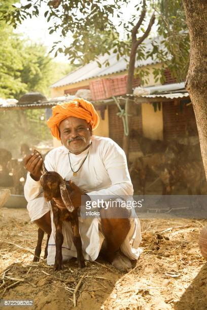 Indian man with goat