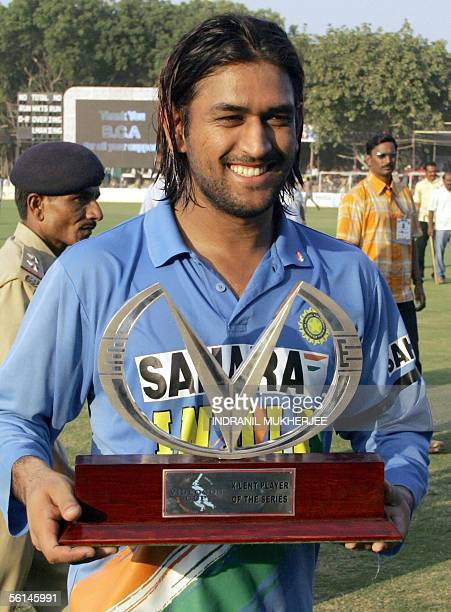 Indian ManoftheSeries Mahendra Singh Dhoni poses with his trophy after the seventh and final one day international match between India and Sri Lanka...
