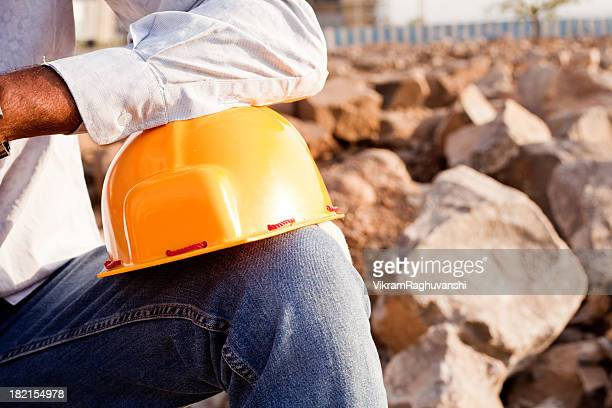 Indian Manual Worker Engineer Holding a Safety Helmet