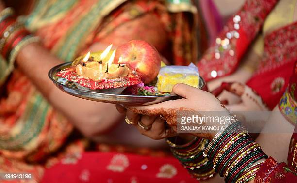 Indian married Hindu women perform rituals during the Karwa Chauth festival in Allahabad on October 30 2015 Karwa Chauth is a traditional Hindu...