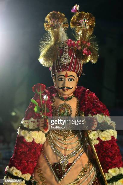 Indian married women carry idols during the Gangaur festival in Ajmer Rajasthan India on 17 April 2019 Gangaur festival is celebrated to honor...