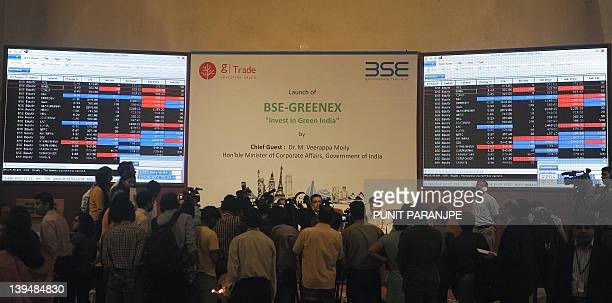 Indian media gather during the launch of new 'BSEGreenex' index at the Bombay Stock Exchange building in Mumbai on February 222012 BSE launched a new...