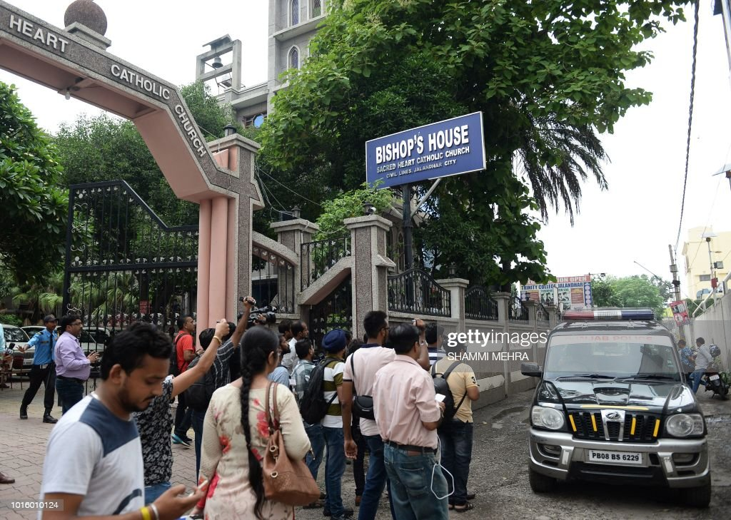 Indian media persons gather around police vehicle in front of Bishop`s house to cover the Kerala state police investigation in relation to bishop...