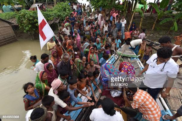 TOPSHOT Indian medical officials of the Jhargaon Public Health Centre distribute medicine to villagers in the flood affected Sagolikota area of...