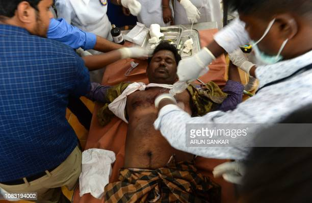 Indian medical staff treat an injured participant at the annual bull taming event 'Jallikattu' in Palamedu village on the outskirts of Madurai in the...