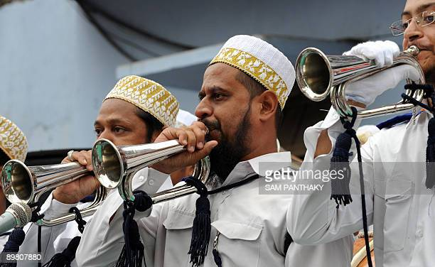 Indian members from the Dawoodi Bohra community's Shabab Volunteer Core blow the bugle during the flaghoisting ceremony at an Independence Day...