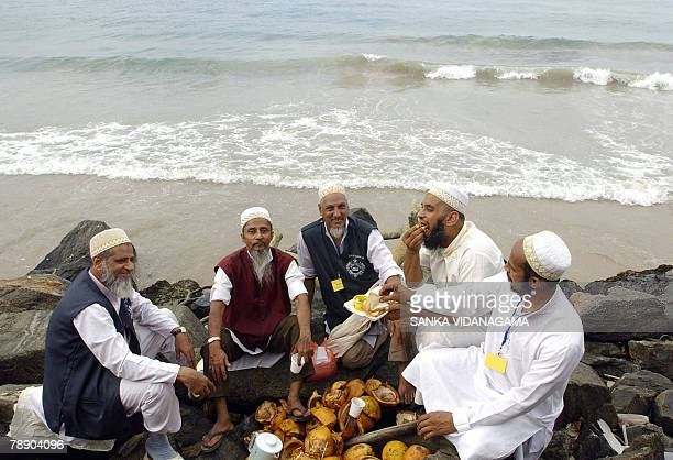 Indian members of an Islamic Shia gathering of the Bohra community have breakfast beside the sea in Sri Lanka's capital Colombo 11 January 2008 Some...