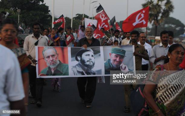 TOPSHOT Indian members of Communist Party of India carry placards bearing the image of former Cuban president Fidel Castro during a remembrance rally...