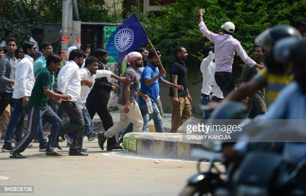 Indian members of Dalit community stage a protest as they try to close the market during a countrywide strike against a Supreme Court order that...