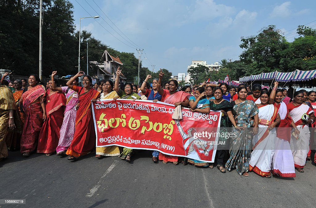 Indian members of National Federation of Indian Women (NFIW) march towards the legislative assembly during a protest against the increasing violence against women in the country in Hyderabad on November 24, 2012. NFIW demands action against the recent rise of violence and oppression against women. AFP PHOTO / Noah SEELAM