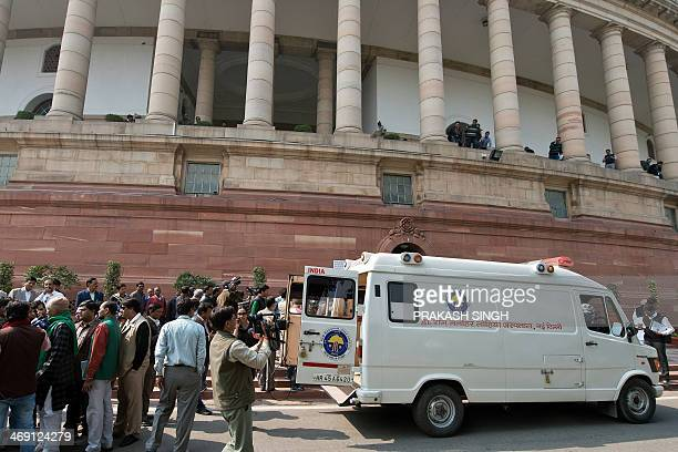 Indian Members of Parliament who were affected by pepper spray are taken to hospital in an ambulance at the Parliament house in New Delhi on February...