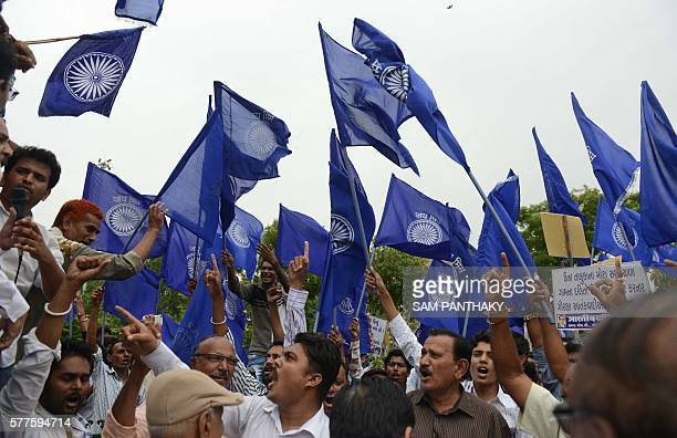 Indian members of the 'Bhartiya Dalit Panther Group' activist group protest against an earlier attack on Dalit caste members in the Gujarat town of...