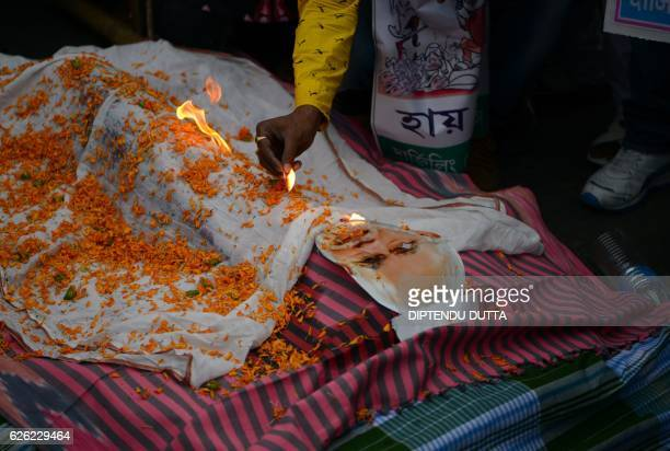 TOPSHOT Indian members of the Congress Party burn an effigy of Prime Minister Narendra Modi during a protest against demonetisation in Siliguri on...