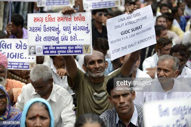 Indian members of the Dalit caste community join attend a protest rally against an attack on Dalit caste members in the Gujarat town of Una in...