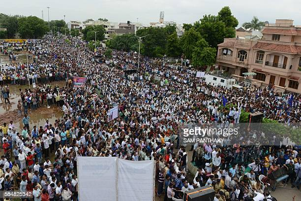 Indian members of the Dalit caste community participate in a protest rally against an attack on Dalit caste members in the Gujarat town of Una in...