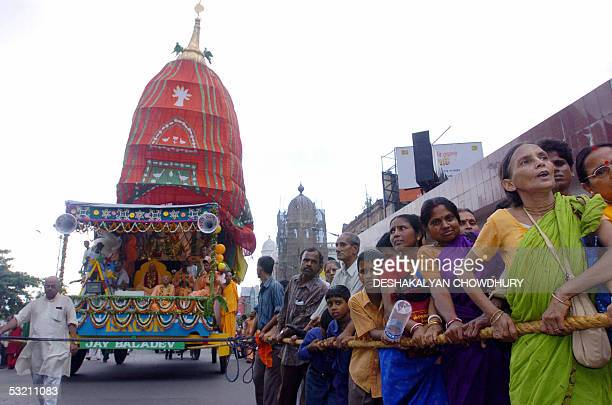 Indian members of the International Society for Krishna Consciousness pull a chariot during the annual Rath Yatra Festival in Kolkata 08 July 2005...