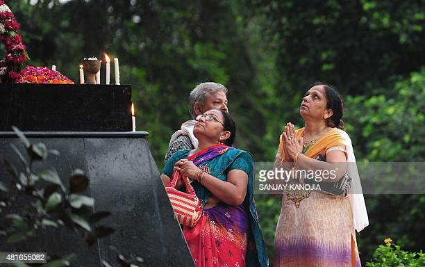 Indian members of the Jai Hind Foundation gesture in front of a statue of Indian freedom fighter Chandra Shekhar Azad during an event to mark his...