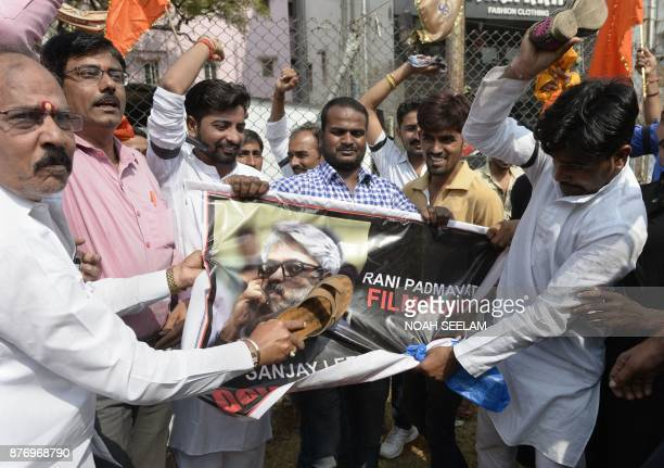 Indian members of the Rajput community tear a poster advertising forthcoming Bollywood film 'Padmavati' during a protest in Hyderabad on November 21...