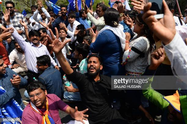 Indian members of the Scheduled Castes shout slogans during a protest against a Supreme Court order that allegedly diluted the Scheduled Castes and...
