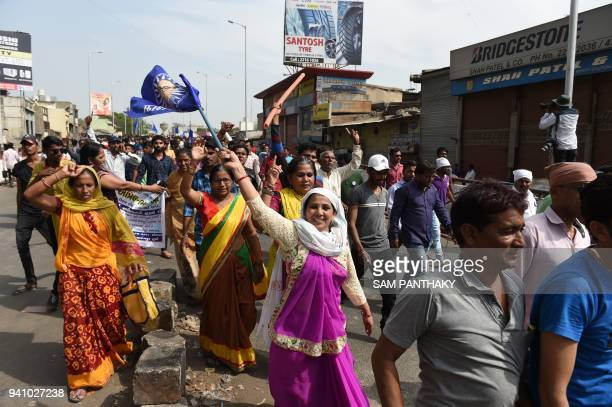 Indian members of the Scheduled Castes take part in a protest against a Supreme Court order that allegedly diluted the Scheduled Castes and Scheduled...