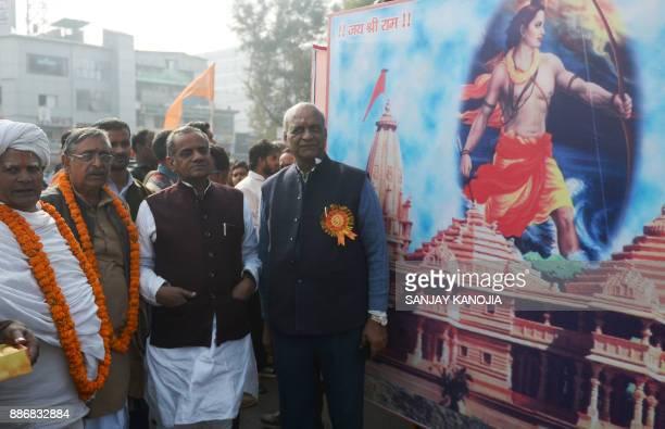Indian members of the Vishwa Hindu Parishad Hindu nationalist group take part in an event to mark 'Shaurya Diwas' the 25th anniversary of the...